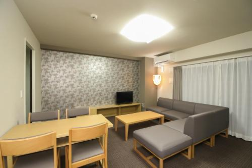 A seating area at Takuto Stay Osaka Hommachi West