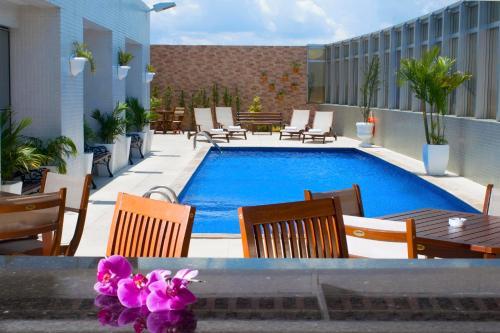 The swimming pool at or close to Holiday Inn Manaus