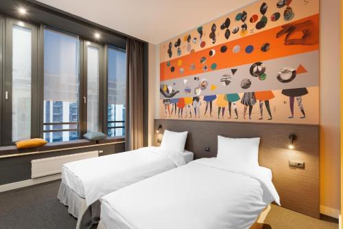 Кровать или кровати в номере Delta Sirius