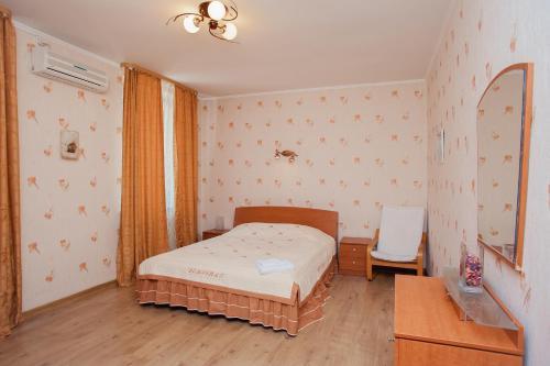 Кровать или кровати в номере Гостиница Стиль