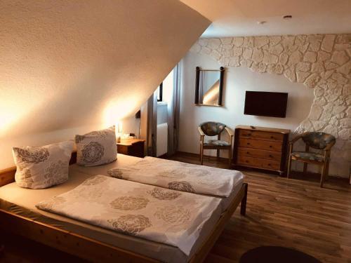 Postel nebo postele na pokoji v ubytování Ferienwohnung Reichelt