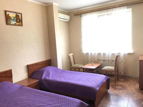 Кровать или кровати в номере Апартаменты Аделина