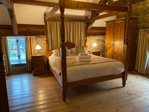 A bed or beds in a room at Gellifawr Woodland Retreat