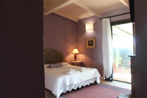 Letto o letti in una camera di Santa Igia - Country House