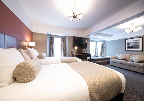 A bed or beds in a room at White Lion Hotel by Innkeepers Collection