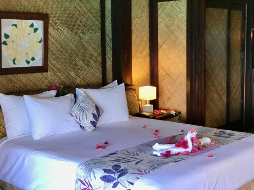 A bed or beds in a room at Maitai Bora Bora