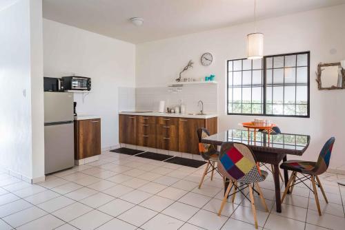 A cozinha ou cozinha compacta de Orchidia 69 apartments