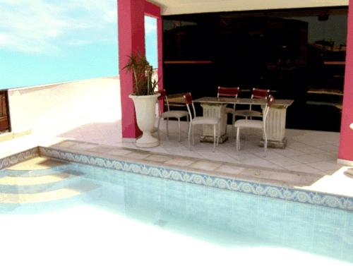 The swimming pool at or near Hotel Rosa Mar