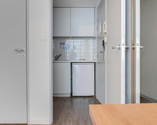 A kitchen or kitchenette at Residhotel Galerie Tatry