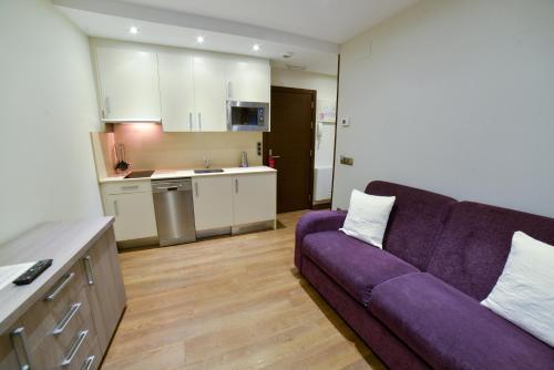 A kitchen or kitchenette at Apartamentos Turísticos Llanes