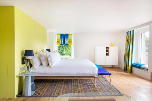 A bed or beds in a room at Cowley Manor Hotel