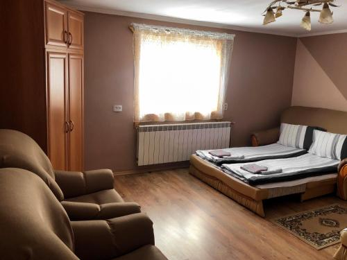 A bed or beds in a room at Taemnytsya Gir