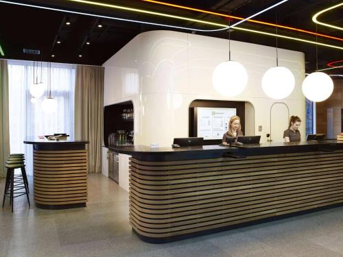 The lobby or reception area at ibis Styles Warszawa City