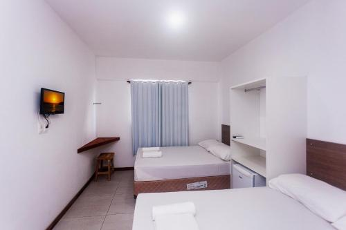 A bed or beds in a room at Economy Suites