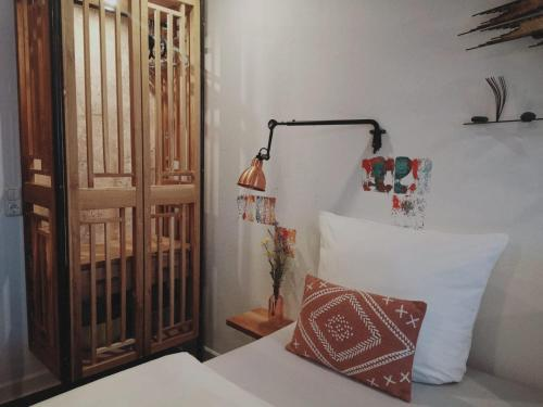 A bed or beds in a room at 36 Phô Cô Guesthouse