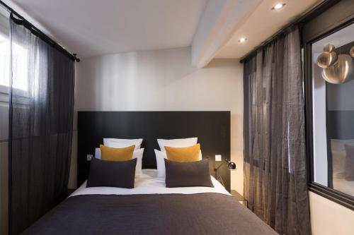 Un ou plusieurs lits dans un hébergement de l'établissement MiHotel Gailleton