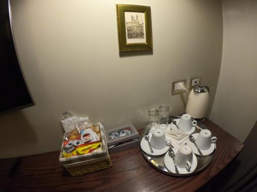 Coffee and tea making facilities at Residenza Roma Imperiale