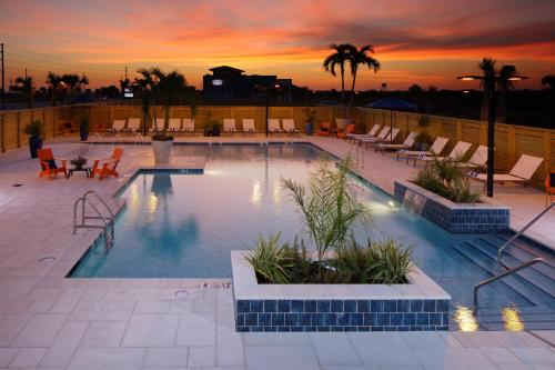 The swimming pool at or near Hotel Indigo Orange Beach - Gulf Shores, an IHG Hotel