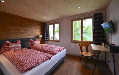 Ein Bett oder Betten in einem Zimmer der Unterkunft Berggasthaus Eggberge