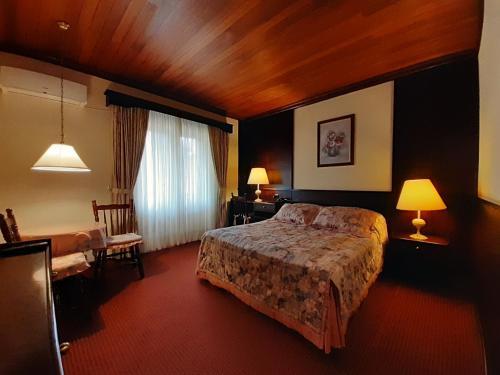 Cama ou camas em um quarto em Hotel Stelter