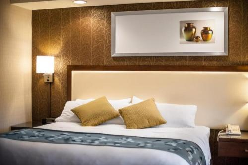 A bed or beds in a room at Radisson Hotel Corning