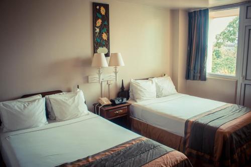 Letto o letti in una camera di Gran Hotel Sula