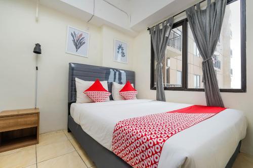 OYO Flagship 483 Tamansari Panoramic Bandungにあるベッド