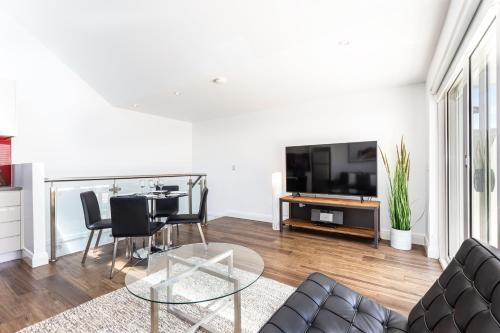 A television and/or entertainment center at Leichhardt Self-Contained Modern One-Bedroom Apartment (9NOR)