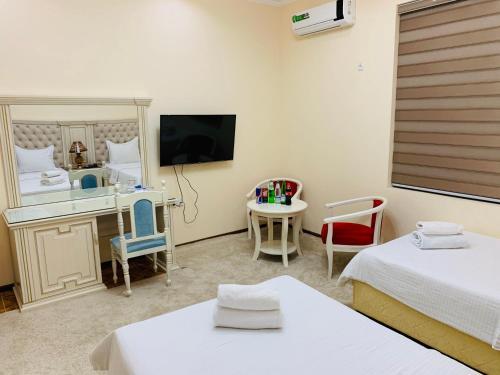 Телевизор и/или развлекательный центр в Amina hotel