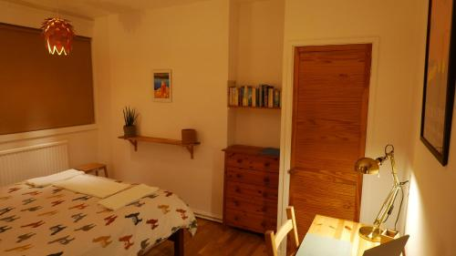 A bed or beds in a room at Double room with a view over north London