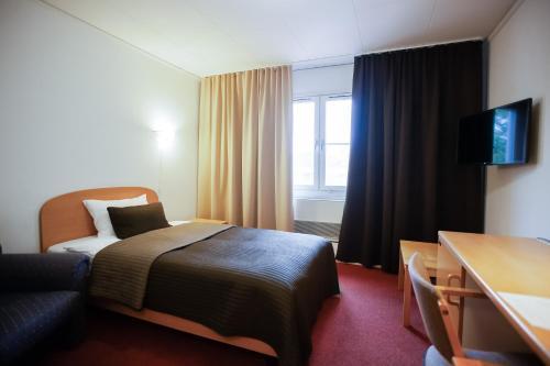 Кровать или кровати в номере Отель «Шведская Деревня»
