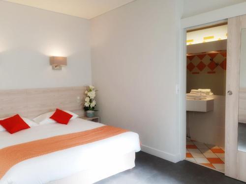 Un ou plusieurs lits dans un hébergement de l'établissement Hostellerie De Bretonniere