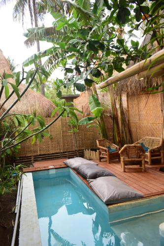 The swimming pool at or close to Meno Island Villas