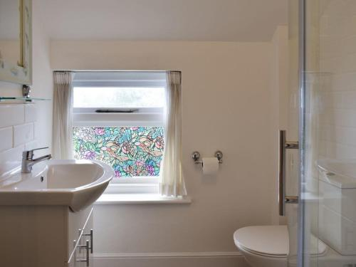 A bathroom at Beech Cottage