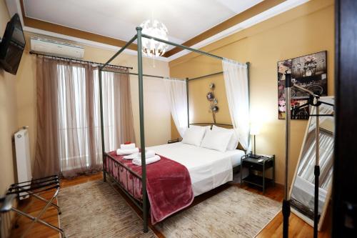 מיטה או מיטות בחדר ב-Athens Heart Apartments