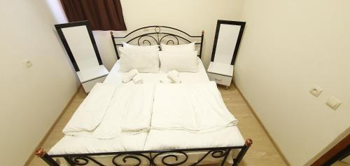 A bed or beds in a room at Tempus Hotel-Hostel