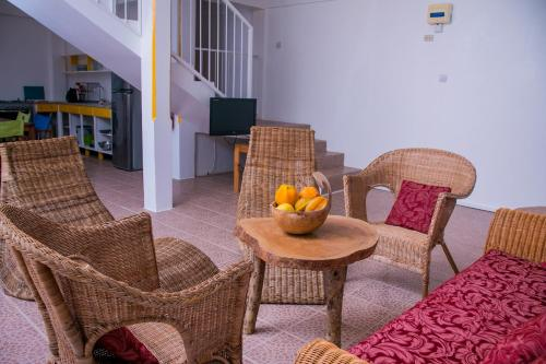 A seating area at Mango Garden Cottages