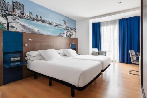 A bed or beds in a room at Eurostars Blue Coruña