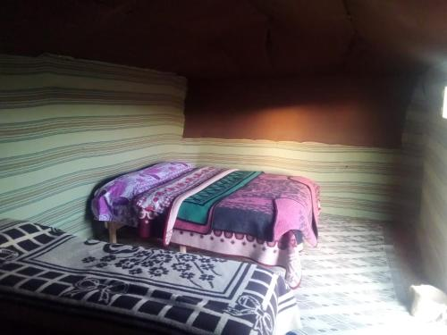 A bed or beds in a room at Camel Trek Bivouac