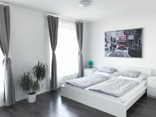 A bed or beds in a room at Apartment Husova