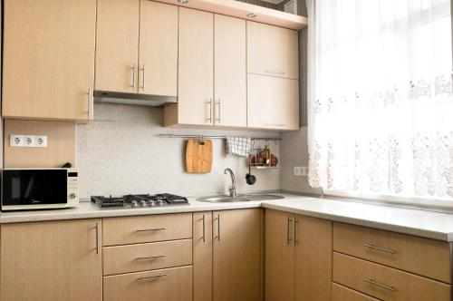 A kitchen or kitchenette at Двухкомнатная квартира на ул Тельмана 50А