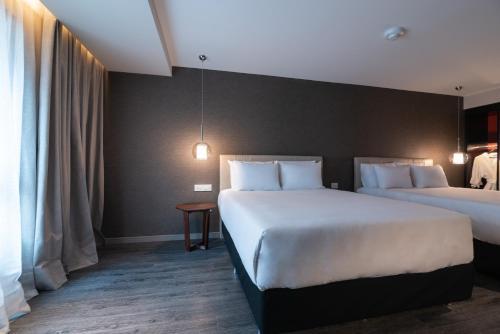Cama ou camas em um quarto em Soro Montevideo, Curio Collection By Hilton