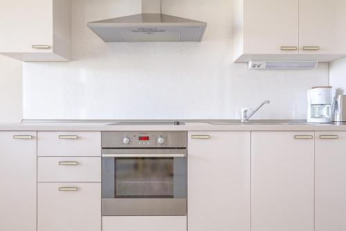 A kitchen or kitchenette at Luxury Apartments Villa Luce