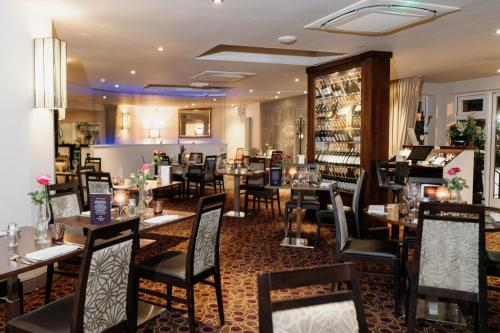 A restaurant or other place to eat at Best Western Ivy Hill Hotel
