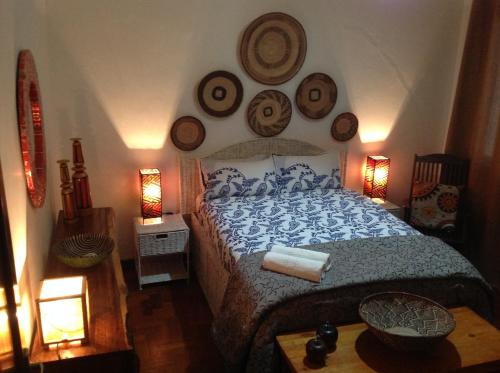A bed or beds in a room at Malagueta Inn