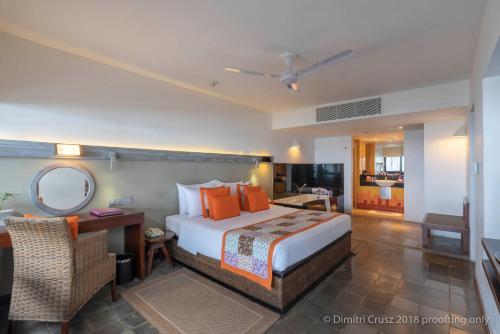 Кровать или кровати в номере Hikka Tranz by Cinnamon