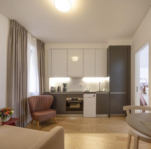 A kitchen or kitchenette at Lisbon Serviced Apartments - Santos