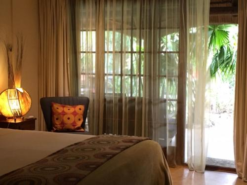 A bed or beds in a room at Afrikhaya Guest House
