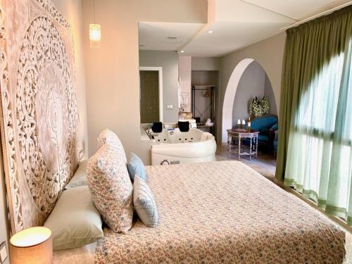 Cama o camas de una habitación en Hotel Spa Adealba