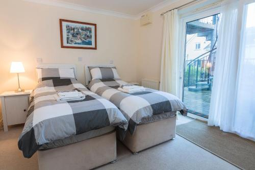 A bed or beds in a room at 19 Bolt Head
